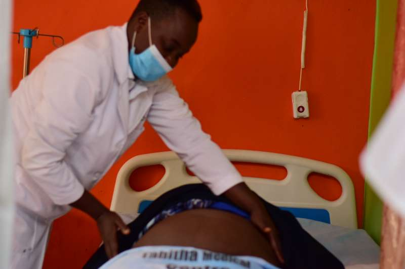 Nurse at a Nairobi private clinic attending to a mother