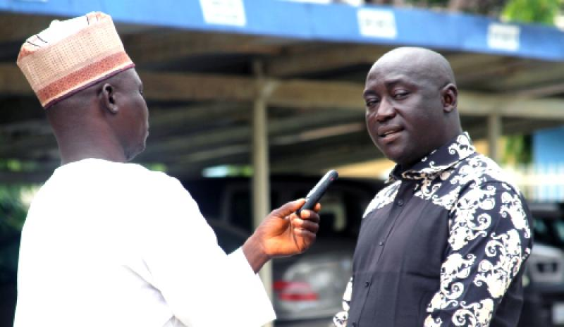 MamaYe State Coordinator, Gideon Poki, answering questions from a journalist