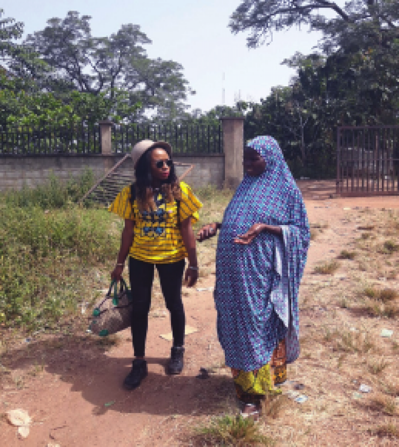 Ijeoma and Amina at Internally Displaced Persons' camp talking about pregnancy
