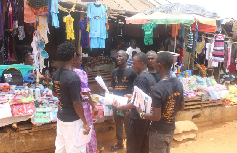 Young activists provide safe clinic messages to market women in Bonthe