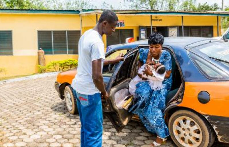 Taxi driver safely delivering pregnant woman to the hospital in Ghana